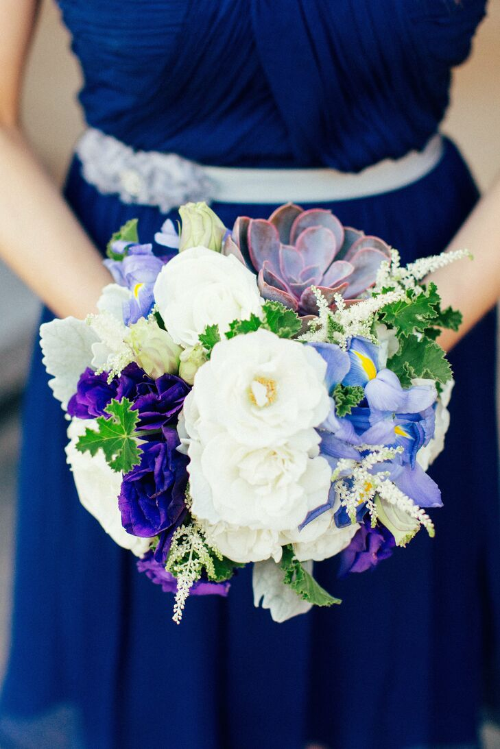 Erin's bridesmaids carried a variety of white, blue and purple flowers combined with rustic succulents.