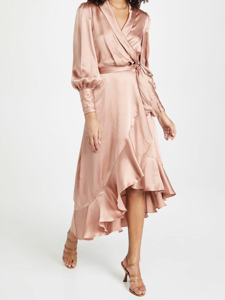Zimmermann silk wrap dress with long sleeves and high low hemline in blush