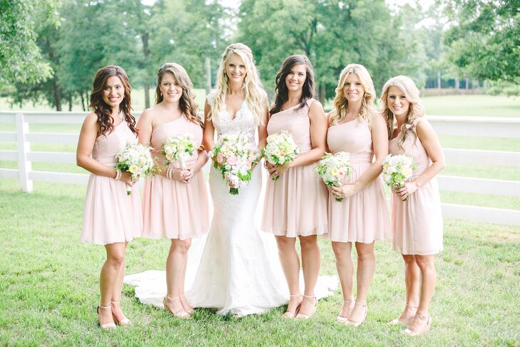 """I've been a Mori Lee runway model for years and had my bridesmaids in a short blush style, keeping in line with a Georgia peach feel,"" says Jessie."