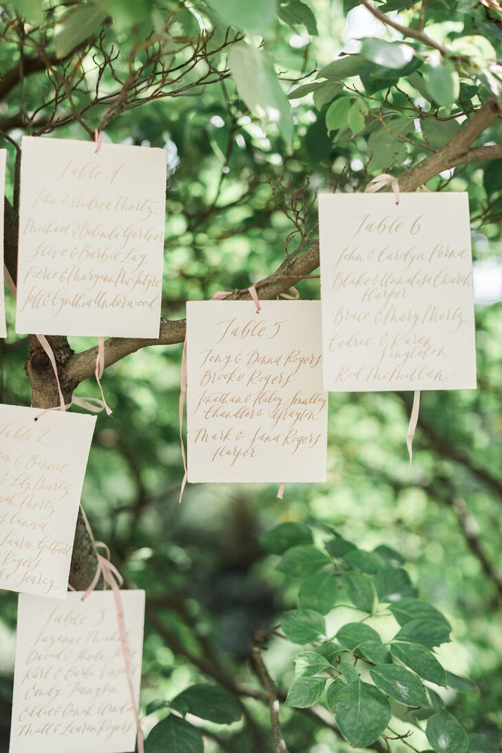 A calligrapher handwrote the place cards, which were hung from a tree just outside the ceremony space.