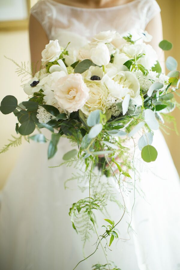 Woo Jin's bouquet combined elegant white roses, peonies and tulips with eucalyptus and herbs.