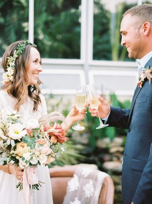 Bohemian Couple Toasting with Champagne at Private Elopement