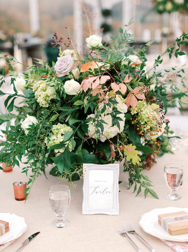 Large centerpiece filled with lush greenery