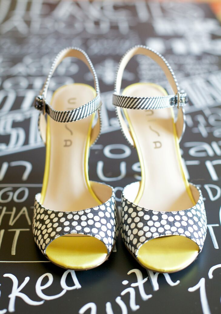 Sandra wore a fun pair of polka dot and striped sandals with her wedding gown.