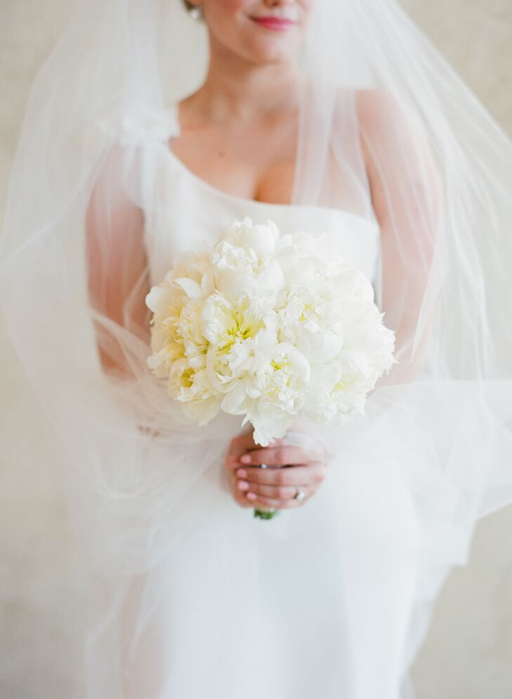 "Lynn carried a perfectly round bouquet of white peonies for her modern wedding. ""I love the way peonies smell and how they look,"" she says. ""I knew I wanted these for my bouquet."""