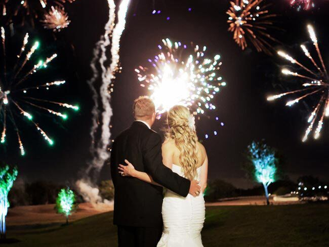 Bride and Groom Standing Watching a Fireworks Show
