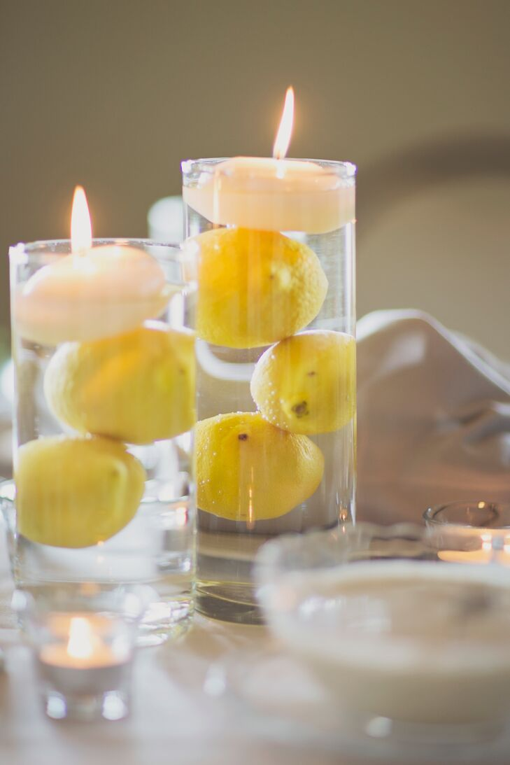The reception tables were decorated with lemon-filled vases topped with floating candles to match the summer wedding.