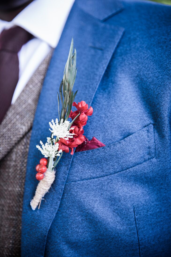 Kelechi wore a deep blue suit, accentuated by a brown tweed vest, which matched the tweed suits worn by his groomsmen. Maroon ties, brown shoes and handmade boutonnieres topped off the look.