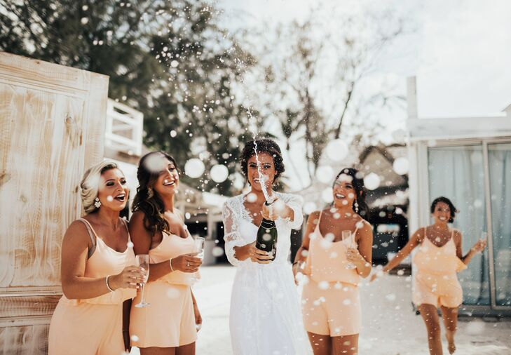 Bridesmaids donned peach rompers while they were beautifying for Angelica and John's ceremony. They later changed into peach strapless dresses for the reception at Huracan Cafe in Punta Cana, Dominican Republic.