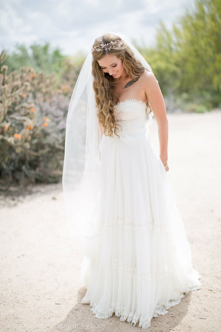"""Amanda ordered her flowing Inbal Dror gown without trying it on. She fell in love with the dress online and ordered it immediately. """"I was able to try on another gown by her with a similar bodice, which helped, but I was confident in her gowns from the moment I saw them,"""" she says."""