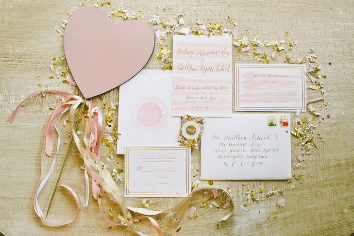 The invitations were printed on white stationery splashed with pink watercolor designs and gold calligraphy. This perfectly followed the romantic palette of pink, ivory and gold.