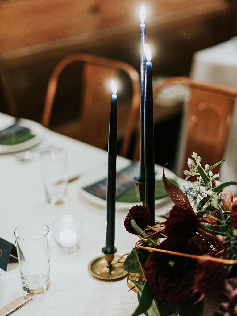 dark taper candles wedding centerpiece