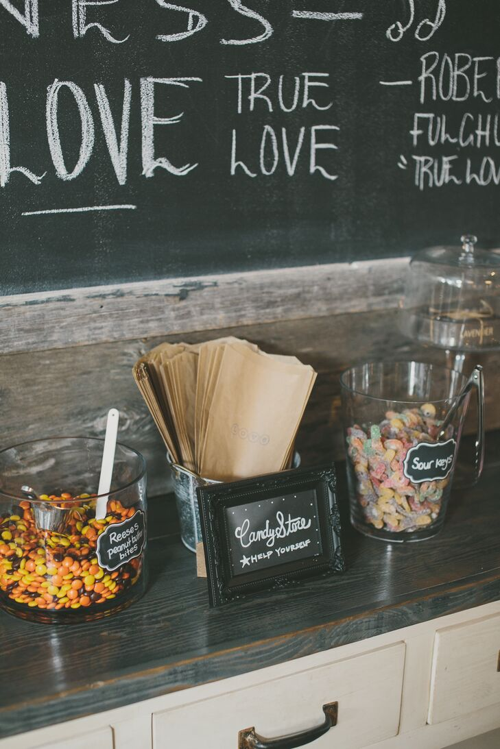 Jars filled with assorted candies were lined along a wall shelf for guests to enjoy at the couple's reception at Ruby Watchco Restaurant.