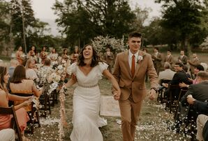 Outdoor Bohemian Recessional with Vintage Wedding Dress and Light Brown Suit