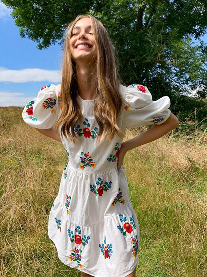 White floral mini dress with puff sleeves