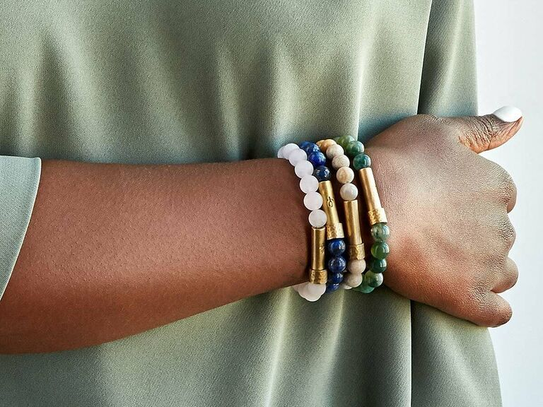 Woman wearing wishing bracelets including coral jade option