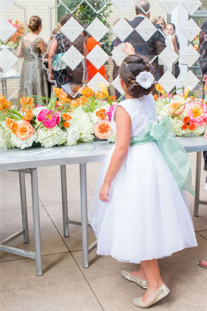 The three flower girls wore white dresses with big skirts and a green bow around their waist in fabric that matched the color of the bridesmaid dresses.