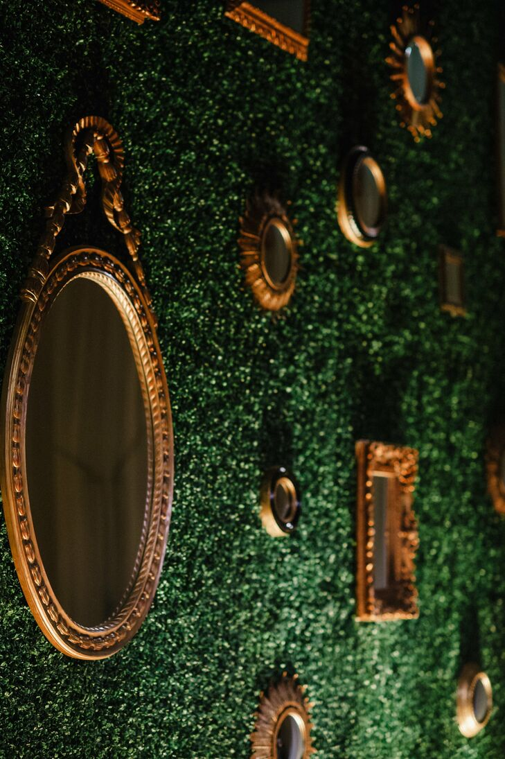 Antique gold mirrors hung from a lush green wall serving as a stunning backdrop for the live band.