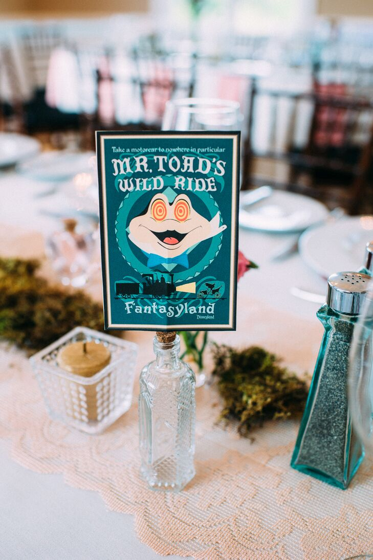 """Their Disney inspiration also made its way into the reception. The couple used vintage theme park posters to name every table atop a glass apothecary bottle. """"We wanted to incorporate Disney without going too crazy,"""" Kim says. The accents served as a burst of nostalgia and a nod to their favorite rides."""