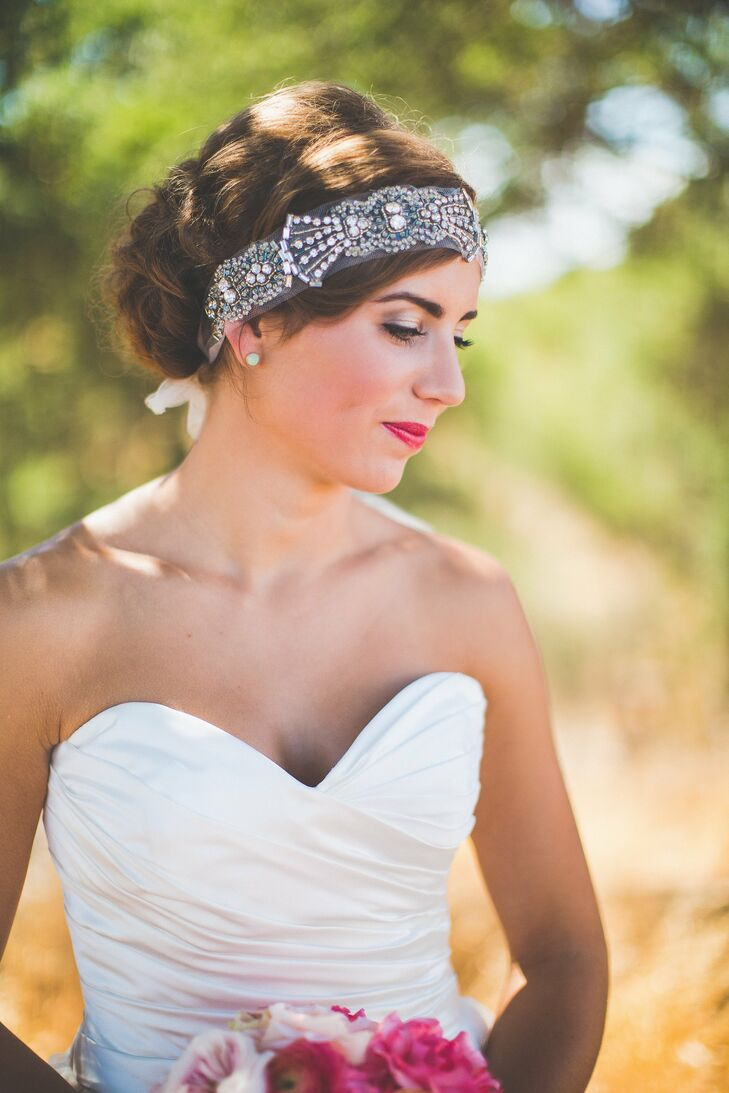 Lauren accented her loose romantic updo with a 1920's inspired crystal headband that gave her look a glamorous, vintage feel.