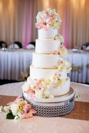 Five-Tier White Fondant Cake with Cascading Flowers