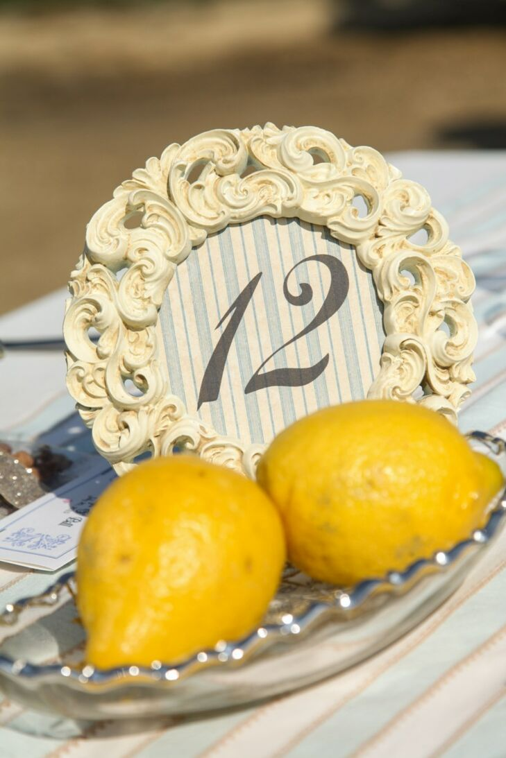 Table numbers at the reception were patterned and framed with antique photo frames and lined with interesting farm-fresh details -- like these lemons.