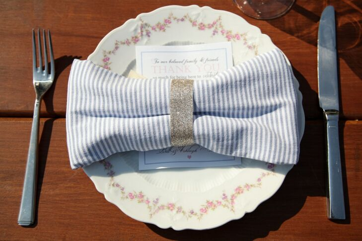 Guests ate off of antique floral patterned china. Stripped linens were made into bows with napkin rings and placed over menu cards at the reception.