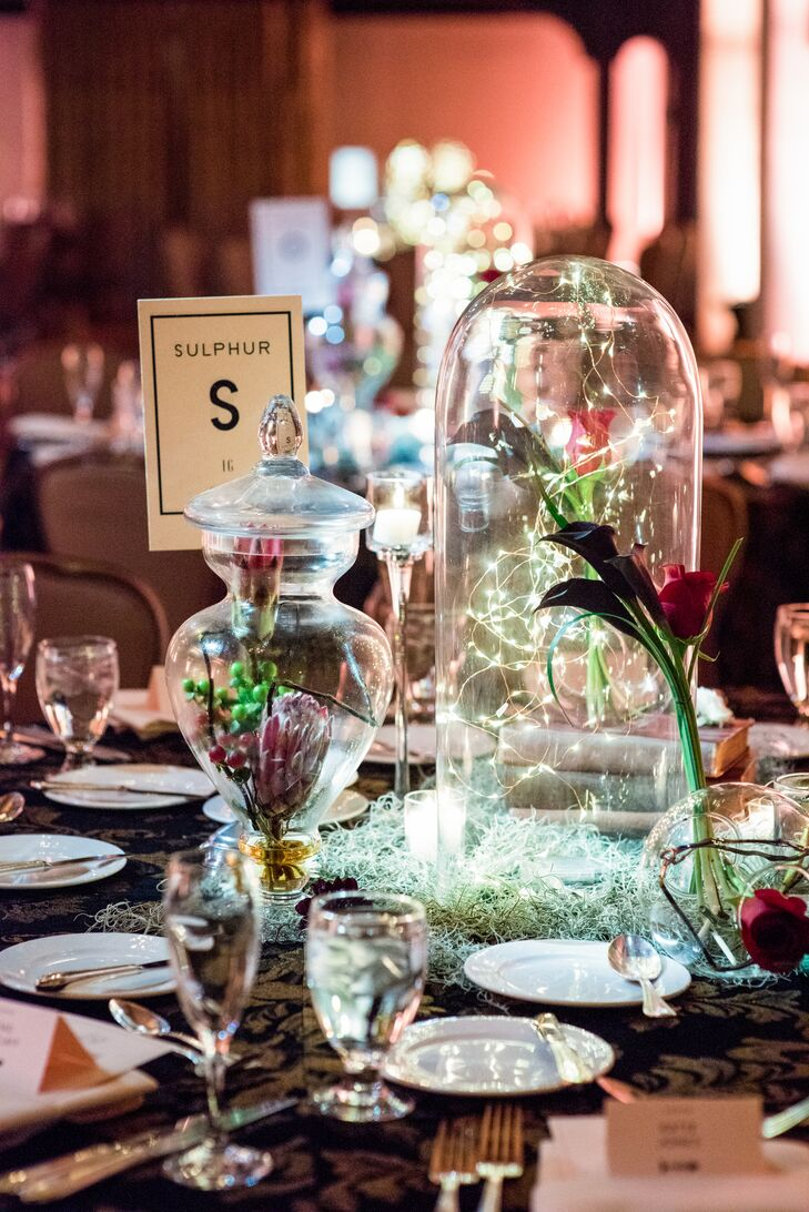 Each table was named for an element from the periodic table (such as copper, mercury and gold). Centerpieces were crafted from black curly willow, stacks of vintage books and apothecary bell jars filled with tiny lights—appearing as self-contained galaxies.