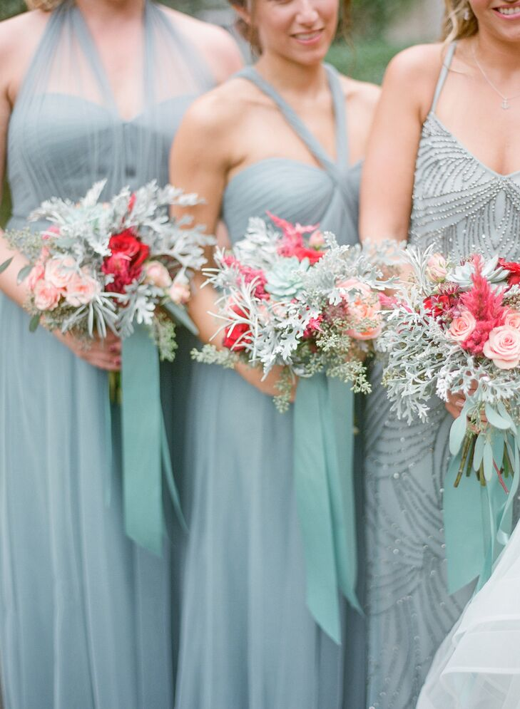 When it came to the flowers, Stefanie let planner Jackie take the lead. She didn't disappoint, creating romantic, loosely tied bouquets of dusty miller, roses and astilbes in shades of slate blue and pink that popped against the gray-blue bridesmaid gowns.