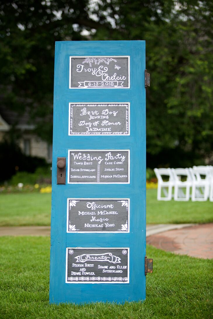 In order to reduce paper waste of wedding programs, Chelcie and Troy upcycled an old door into their itinerary for the wedding. The door was painted blue for a bold pop of color and each section was done to look like little chalkboards.