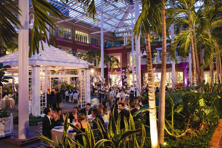Large palm trees surrounded the tables for the atrium reception.