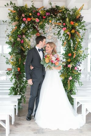 Elegant, Romantic Couple with Greenery Wedding Arch