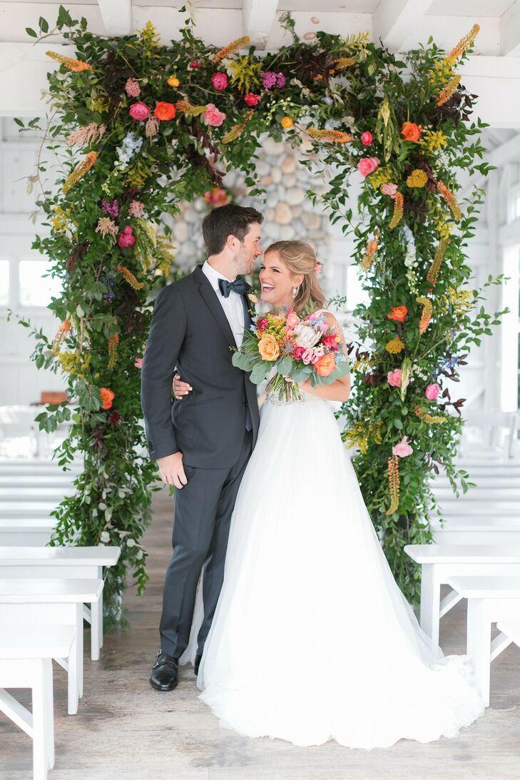 Elegant, Romantic Couple with Greenery Wedding Arch