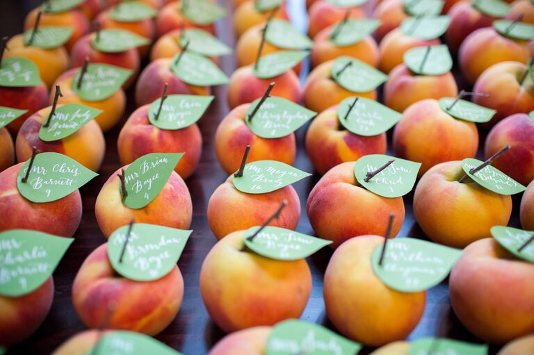 Fresh peach with calligraphy paper leaf escort cards