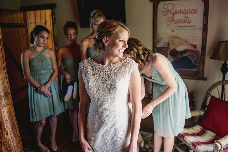 Erin donned an lacy A-line dress with an illusion neckline. Her bridesmaids chose from a variety of J.Crew dresses in a dusty shale color.