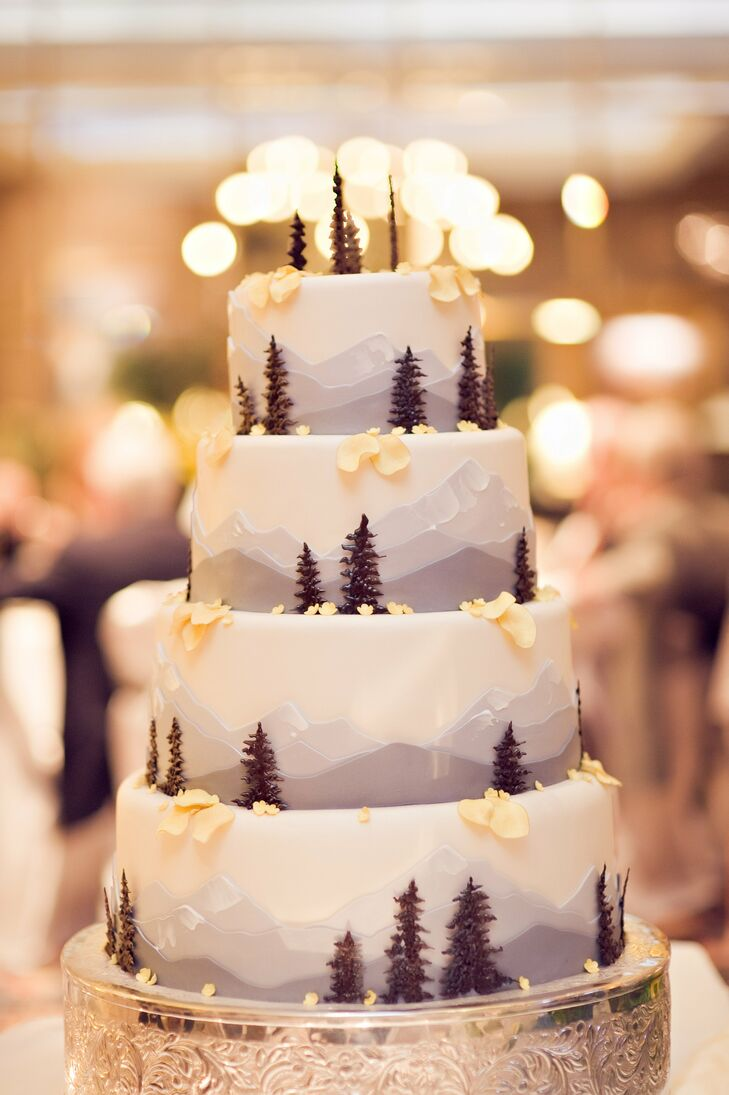 Katie and Derek wanted to incorporate mountain scenery into the cake, so the baker painted a frosting mountainscape and added trees made of chocolate.