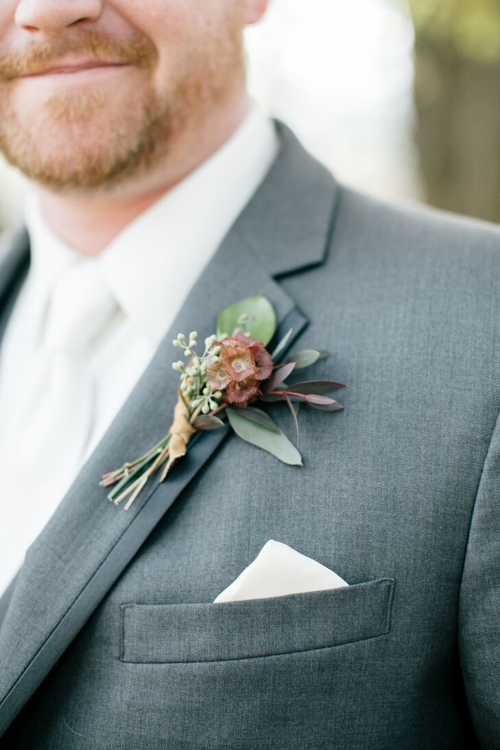 Bo's boutonniere was made of scabiosa pods.