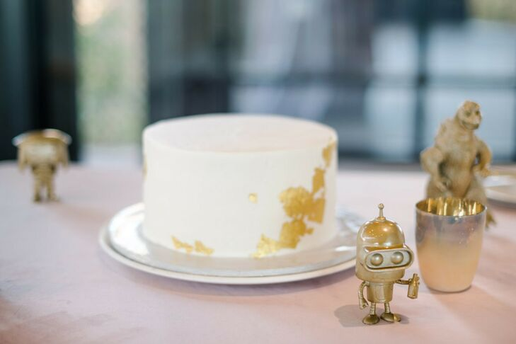 White Single Tier Wedding Cake with Gold Foil Accents