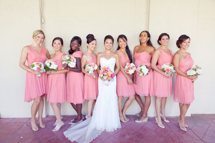 Minh stood with her bridesmaids, who were all dressed in coral colored dresses with a variety of styles.