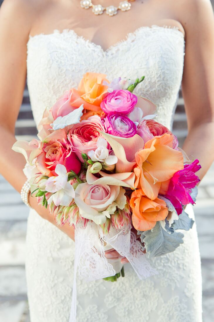 Minh had a pink and orange bridal bouquet with a variety of roses and lilies held together with lace.