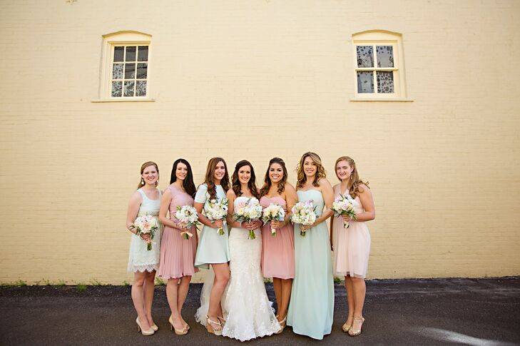 """Knowing that her bridesmaids were comfortable and happy with what they wore on her wedding day was important to Alexis. She had the girls choose their own dresses, each in a shade of blush or mint. """"My mom suggested that the girls wear both mint and blush,"""" Alexis says, """"and I thought she was crazy because the thought of mismatched dresses with multiple shades of two colors sounded like a disaster.  Luckily, it came out beautifully."""""""
