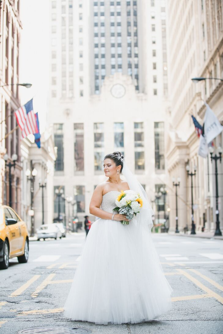"""Before even trying on dresses, Alyse found the ultimate pair of wedding shoes — a pair of shimmery Christian Louboutin's — while she was on vacation in Paris with Vadim and had to have them. """"I figured that since my shoes wouldn't be visible under a long dress, I might as well buy shoes that were comfortable and fun,"""" says Alyse. The search for the perfect wedding dress wasn't quite as straight forward. After several visits to local bridal salons, Alyse still hadn't come across anything that packed the wow-factor she was after. That is, until she visited Diana's Bridal for a sample sale. """"I found that they had a new line of dresses that were that were designed in-house and handmade in Turkey,"""" she says. While she never dreamed she would say """"I do"""" in a glam ball gown, it was this whimsical style from the salon's own collection that ultimately won the bride-to-be over. """"It was unique, elegant and fit perfectly,"""" says Alyse."""