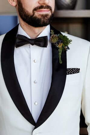Modern Groom with White Tuxedo Jacket, Boutonniere and Bow Tie