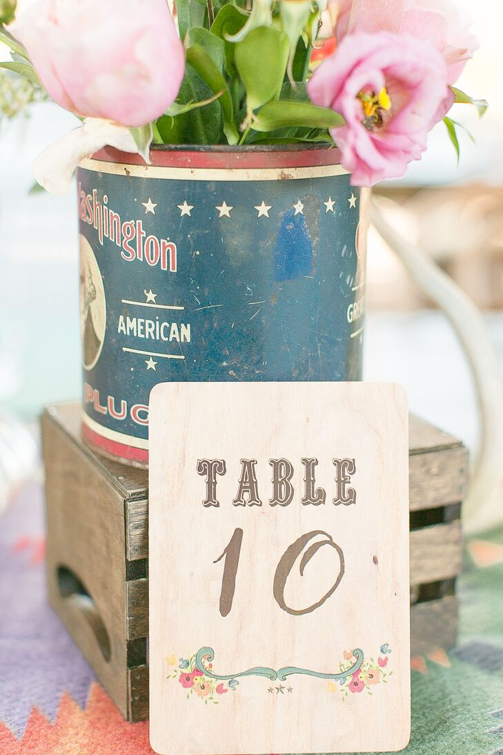 Katie and Austin loved the wood paper design on the invitation suite so much that they used the same background for their table numbers. The team at Dogwood Blossom Stationery & Invitation Studio made each one with a western-inspired font for some added rustic flair.