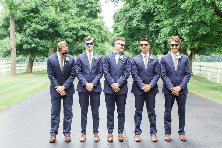 Jordan and his groomsmen wore navy chino suits from J.Crew's Ludlow collection.  The groomsmen wore long gold ties and Jordan wore a navy striped bow tie. The boutonnieres were white ranunculus, white pearl yarrow and dusty mint leaves.