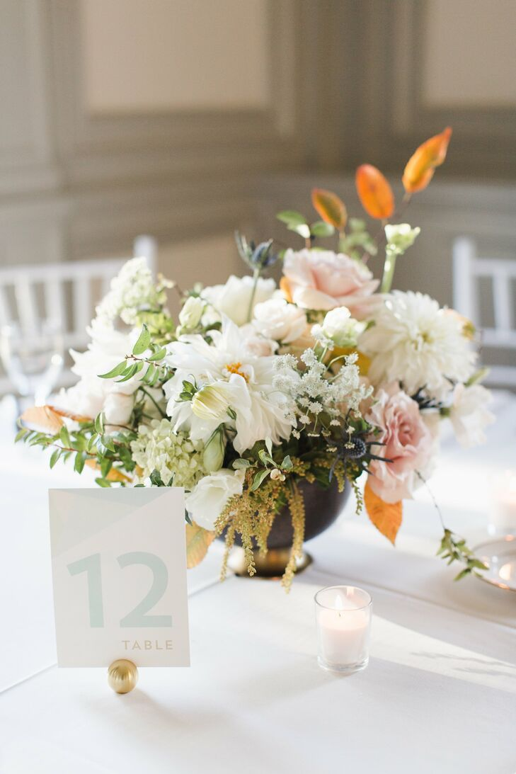 A Blush and White Centerpiece with a Modern Table Number