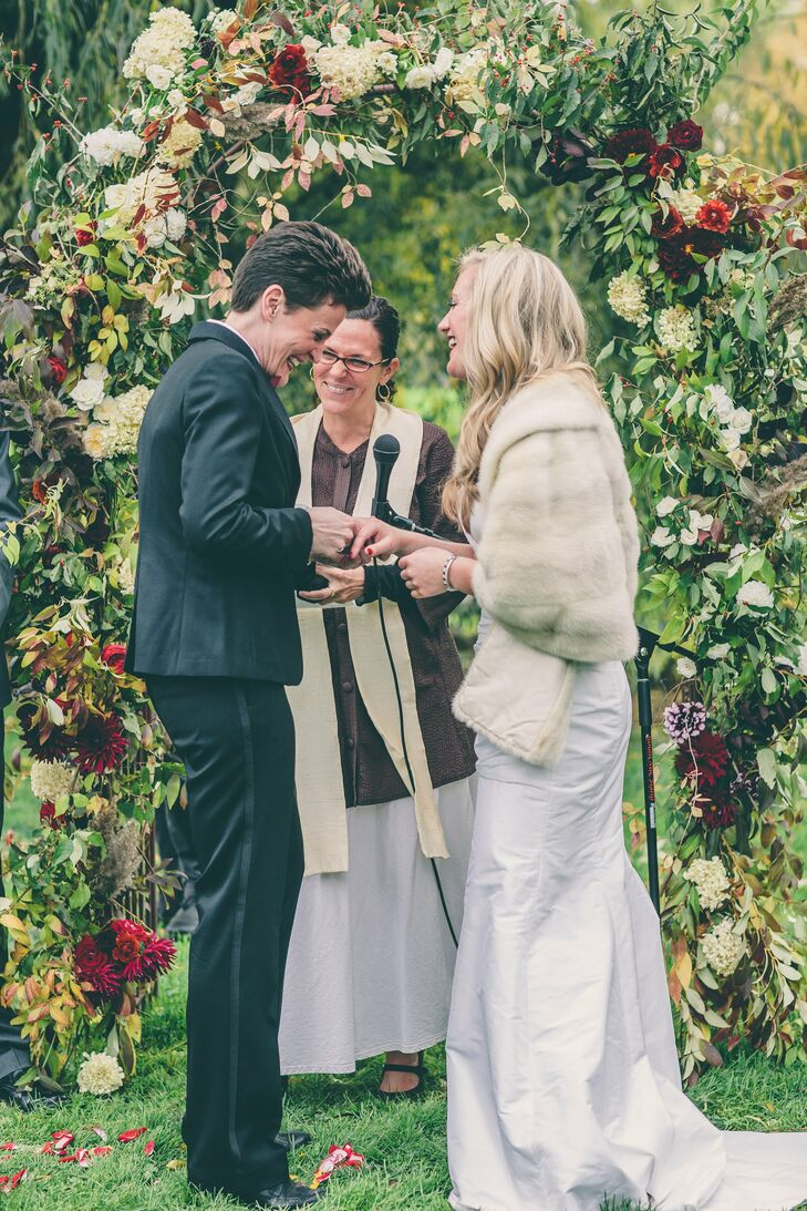 Anja and Kellye wed under a large weeping willow tree. A floral arch in the pair's wedding colors served as the backdrop for the ceremony.