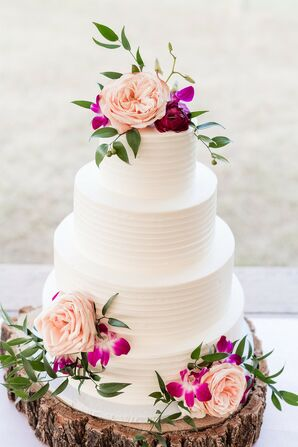 Elegant Tiered Cake with Pink Flowers and Wood Stand