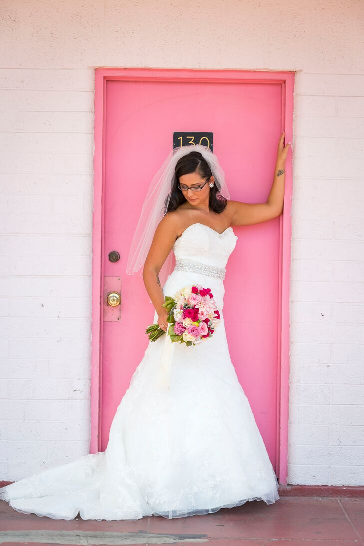 The bride donned a white trumpet style gown by David Tutera, a medium-length veil and light pink pumps.
