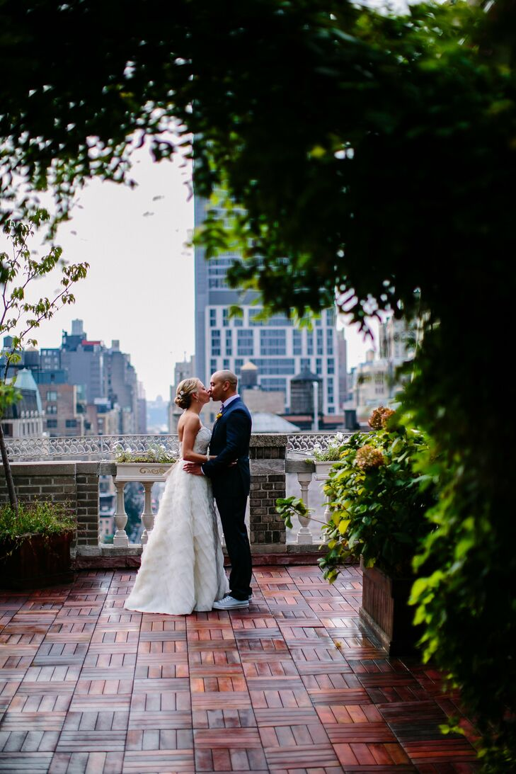 A rooftop ceremony in Manhattan paired with DIY details, mason jars and whimsical colors created gave Krista and Del's urban affair plenty of modern c